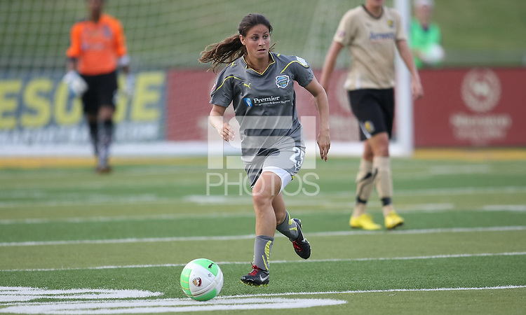 Philadelphia midfielder, Tina DiMartino (25), dribbles upfield.  DiMartino scored Philly's only goal against her former team, FC Gold Pride.  League leaders FC Gold Pride defeated the Philadelphia Independence, 3-1, in West Chester, PA.