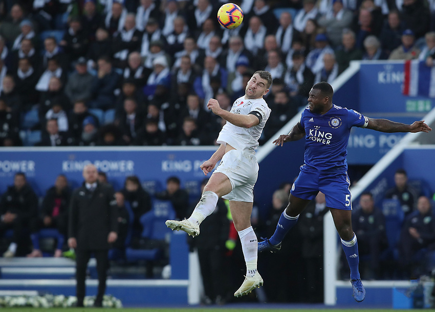 Burnley's Sam Vokes and Leicester City's Wes Morgan<br /> <br /> Photographer Rachel Holborn/CameraSport<br /> <br /> The Premier League - Saturday 10th November 2018 - Leicester City v Burnley - King Power Stadium - Leicester<br /> <br /> World Copyright © 2018 CameraSport. All rights reserved. 43 Linden Ave. Countesthorpe. Leicester. England. LE8 5PG - Tel: +44 (0) 116 277 4147 - admin@camerasport.com - www.camerasport.com