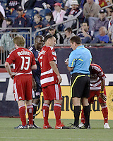The referee Jeff Gontarek hands out one of many yellow cards in the game to New England Revolution midfielder Joseph Niouky (23) who fouled FC Dallas midfielder/forward Daniel Hernandez (2).  The New England Revolution drew FC Dallas 1-1, at Gillette Stadium on May 1, 2010