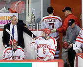 Mike Geragosian (BU - Volunteer Assistant Coach), Sean Escobedo (BU - 21), David Warsofsky (BU - 5), Max Nicastro (BU - 7), Larry Venis (BU - Senior Associate Head Athletic Trainer), Mike DiMella (BU - Equipment Manager) - The Boston University Terriers defeated the Merrimack College Warriors 6-4 (EN) on Saturday, January 16, 2010, at Agganis Arena in Boston, Massachusetts.