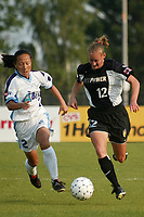 Liping Wang of the Atlanta Beat races Krista Davey of the New York Power for the ball during the Beat's 2-0 shut out of the Power on June 9th at Mitchel Athletic Complex.