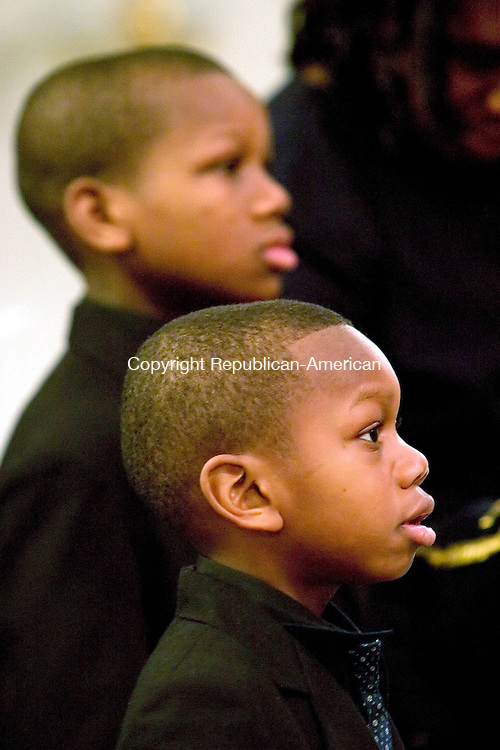 WATERBURY, CT -16 January 2005 -011606JS03---Isaac Parker, 5, of Waterbury and his brother Jesse, 9, listen to members of the clergy during the Concern Black Clergy Council's third annual King's Dream in Action celebration held Monday at the Rehobeth Church of God in Christ Jesus in Waterbury.      --- Jim Shannon Republican-American --  Rehobeth Church of God in Christ Jesus; Waterbury, Isaac Parker, Jesse Parker are CQ