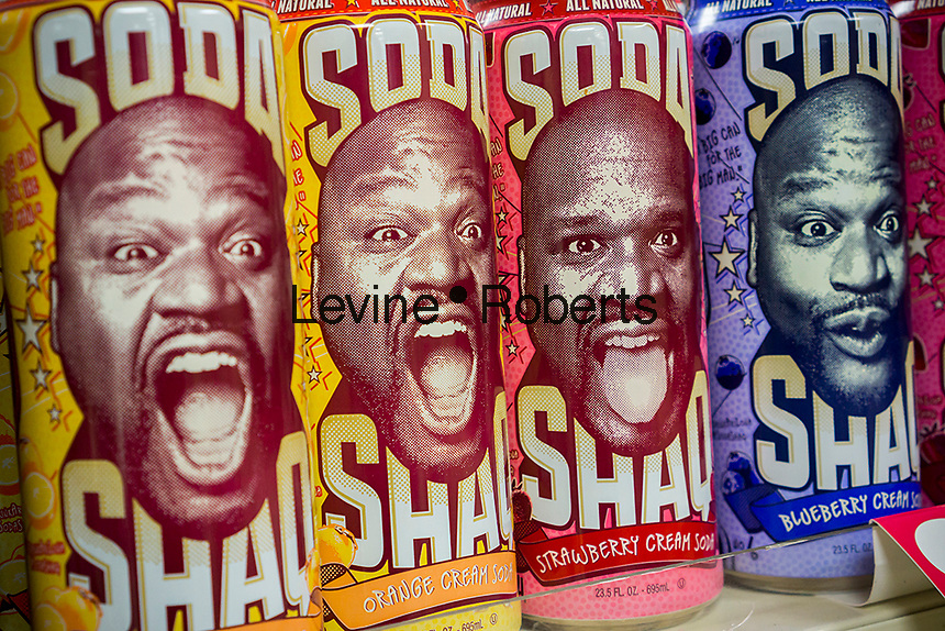 Cans of Shaq soda are seen on the shelves of a 7-Eleven in New York on Friday, June 28, 2013. The Shaquille O'Neal branded soda is manufactured by Arizona Beverages and is available in several flavors. (© Richard B. Levine)