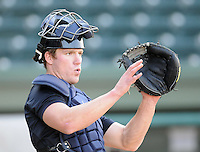 Catcher Jeff Farnham (23) of the Charleston RiverDogs, Class A affiliate of the New York Yankees, prior to a game against the Greenville Drive on April 11, 2011, at Fluor Field at the West End in Greenville, S.C. Photo by Tom Priddy / Four Seam Images