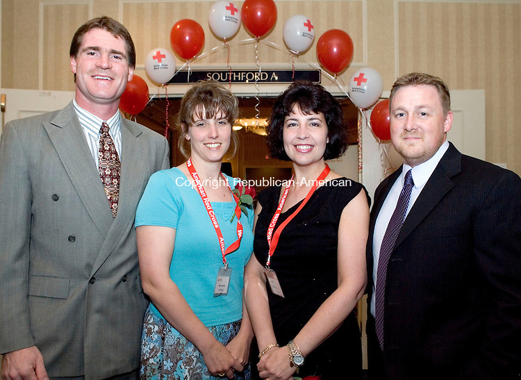 SOUTHBURY, CT- 04 MAY 2008- 050408JT19-<br /> From left, Peter Hopkins with wife and medical award recipient Sherri Hopkins, fellow medical award recipient Lisa Herchenroether and husband George during the American Red Cross' &quot;Images of Heroes&quot; gala on Saturday, May 3 at the Crowne Plaza in Southbury. Other award recipients were Jesse Giguere with global impact, Kendrik Lechner with good samaritan (youth), Meghan Edwards with good samaritan (adult), and Laura Coffin with community impact.<br /> Josalee Thrift / Republican-American
