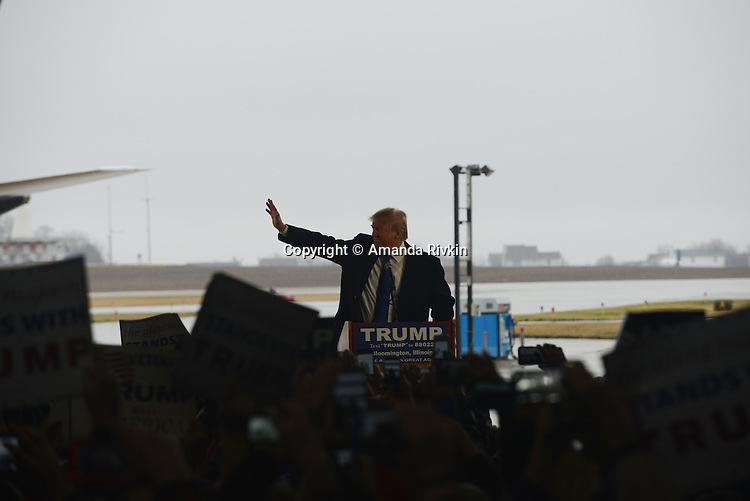 Republican Presidential front runner Donald Trump arrives at the podium at the Synergy Flight Center in Bloomington, Illinois on March 13, 2016.