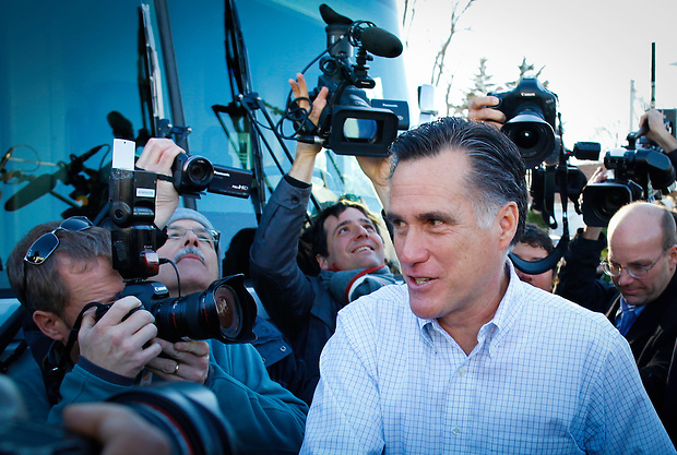 Mitt Romney greets a supporter while making his way to his tour bus following a campaign stop at The Family Table restaurant in Atlantic, Iowa on Sunday, January 1, 2012.  (Christopher Gannon/GannonVisuals.com/MCT)