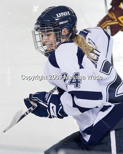 Courtney Birchard (UNH - 24) - The University of Minnesota-Duluth Bulldogs defeated the University of New Hampshire Wildcats 4-1 in their NCAA Quarterfinal meeting on Saturday, March 14, 2009, at the Whittemore Center in Durham, New Hampshire.