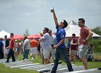 NWA Democrat-Gazette/BEN GOFF @NWABENGOFF<br /> Vincent Tran (left) celebrates as teammate Todd Jackson, both with Advanced Solutions, waits his turn Friday, June 16, 2017, during the Catfish, Corndogs and Cornhole tournament at Mercy Hospital in Rogers. The event is an annual fundraiser hosted by WhyteSpyder, with proceeds from this year's tournament benefiting Mercy Health Foundation. Some 140 teams of two entered this year, according to WhyteSpyder CEO Eric Howerton.