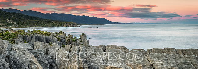 Pancake Rocks at sunrise, limestone formations on wild coast in Punakaiki, Paparoa National Park, Buller Region, West Coast, New Zealand, NZ