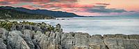 Pancake Rocks at sunrise, limestone formations on wild coast in Punakaiki, Paparoa National Park, Buller Region, West Coast, New Zealand, NZ