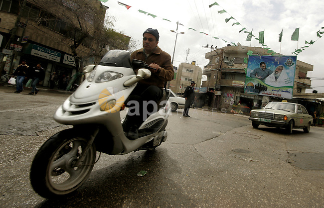 A Palestinian man rides his motorcycle in Rafah in the southern Gaza Strip, on April 4, 2011, a day after Israel demanded that the United Nations bin a report critical of its deadly 2008-2009 offensive on Gaza after the author said he had been wrong to say it had targeted civilians. Photo by Abed Rahim Khatib..
