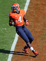 Virginia running back Taquan Mizzell (4) Ball State defeated Virginia 48-27 during an NCAA football game Saturday Oct. 5, 2013 at Scott Stadium in Charlottesville, VA. Photo/Andrew Shurtleff