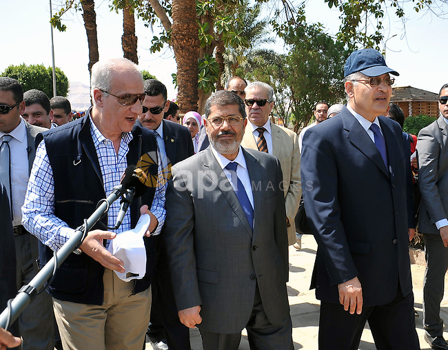 Egyptian President Mohamed Morsi (C) visiting touristic sites in Luxor, Upper Egypt, 03 August 2012. Morsi on 03 August visited Luxor and Karnak temples in Luxor, one day after he swore in a new cabinet. The new Prime Minsiter Hisham Qandil told reporters on 02 August that revitalizing the national economy and bringing security back to the country's streets would be his government's priorities. Photo by EGYPTIAN PRESIDENCY