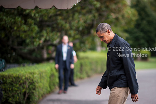 United States President Barack Obama walks to the White House after arriving aboard Marine One on the South Lawn of the White House on August 26, 2012 in Washington, DC. Obama was returning from a weekend stay at Camp David..Credit: Pete Marovich / Pool via CNP