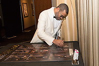 Jordan Peele signs a poster backstage with the Oscar&reg; for original screenplay for work on &ldquo;Get Out&rdquo; during the live ABC Telecast of The 90th Oscars&reg; at the Dolby&reg; Theatre in Hollywood, CA on Sunday, March 4, 2018.<br /> *Editorial Use Only*<br /> CAP/PLF/AMPAS<br /> Supplied by Capital Pictures