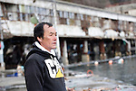 Fisherman Toshiyuki Maekawa stands outside the ruined fish market in the historic city of Kamaishi, Iwate Prefecture, Japan on 04 April, 2011. .Photographer: Robert Gilhooly