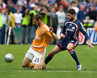 New England Revolution defender (6) Jay Heaps fouls Houston Dynamo forward (21) Nate Jaqua during the MLS Cup Finals at RFK Stadium in Washington, DC.  The Houston Dynamo defeated the New England Revolution, 2-1, to win the Alan I. Rothenberg Trophy.