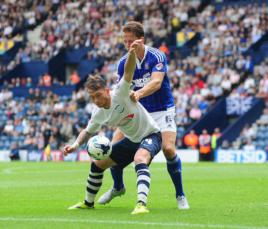 Preston North End's Joe Garner shields the ball from Ipswich Town's Christophe Berra<br /> <br /> Photographer Chris Vaughan/CameraSport<br /> <br /> Football - The Football League Sky Bet Championship - Preston North End v Ipswich Town - Saturday 22nd August 2015 - Deepdale - Preston<br /> <br /> &copy; CameraSport - 43 Linden Ave. Countesthorpe. Leicester. England. LE8 5PG - Tel: +44 (0) 116 277 4147 - admin@camerasport.com - www.camerasport.com