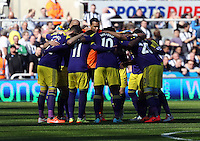 Pictured: Swansea players huddle before kick off. Saturday 19 April 2014<br /> Re: Barclay's Premier League, Newcastle United v Swansea City FC at St James Park, Newcastle, UK.
