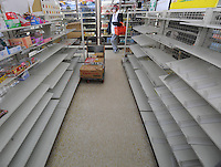 Empty shelves at a small supermaket in Fukushima city, an area, 60 km from the Fukushima Daiichi Nuclear Power Plant. Plant was damaged dring the  Earhquake and following Tsunami that struck Japan on 11th March 2011. With no power or running water and limited supplies of food, people in affected regions are surviving on little food and water, many supermarket stores are queued up with clients buying food and beverages and the stores didn't have many supplies left. <br /> 17 Mar 2011