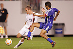 11 March 2008: Chad Barrett (USA) (19) crosses the ball against Yenier Bermudez (CUB) (3). The United States U-23 Men's National Team tied the Cuba U-23 Men's National Team 1-1 at Raymond James Stadium in Tampa, FL in a Group A game during the 2008 CONCACAF's Men's Olympic Qualifying Tournament.