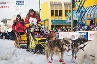 Mitch Seavey and team leave the ceremonial start line with an Iditarider at 4th Avenue and D street in downtown Anchorage, Alaska during the 2015 Iditarod race. Photo by Jim Kohl/IditarodPhotos.com
