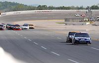 Apr 26, 2009; Talladega, AL, USA; NASCAR Sprint Cup Series drivers Dale Earnhardt Jr and Jeff Burton draft away from the field during the Aarons 499 at Talladega Superspeedway. Mandatory Credit: Mark J. Rebilas-