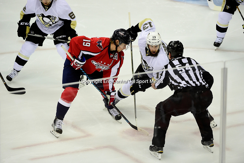 Thursday, April 28, 2016: Pittsburgh Penguins center Nick Bonino (13) and Washington Capitals center Nicklas Backstrom (19) wait for linesman Greg Devorski (54) to drop the puck during game 1 of round 2 of the NHL Eastern Conference playoffs between the Pittsburgh Penguins and the Washington Capitals held at the Verizon Center in Washington DC. The Capitals defeat the Penguins 4-3 in overtime. Eric Canha/CSM