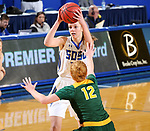 BROOKINGS, SD - JANUARY 6: Tagyn Larson #24 from South Dakota State University looks for a teammate while being pressured by Sarah Jacobson #12 from North Dakota State University  during their game Saturday afternoon at Frost Arena in Brookings, SD. (Photo by Dave Eggen/Inertia)