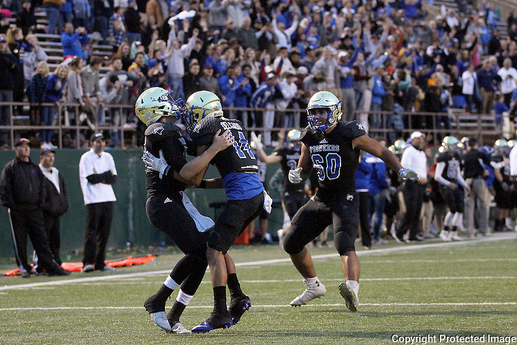 Saginaw Boswell freshman quarterback Brayden Thomas, left, celebrates his late 4th quarter touchdown with Chris Delgado and Kyrese Mcfarland during their 20-10 win against Lubbock Cooper in 5A Division II Region I semi-final high school football playoff at Memorial Stadium in Wichita Falls on Saturday, November 26, 2016.