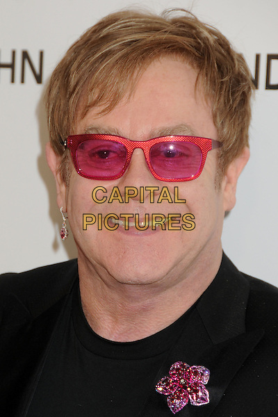 Elton John.21st Annual Elton John Academy Awards Viewing Party held at West Hollywood Park, West Hollywood, California, USA..February 24th, 2013.oscars headshot portrait black pink sunglasses shades brooch flower.CAP/ADM/BP.©Byron Purvis/AdMedia/Capital Pictures.