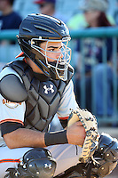 Aramis Garcia (18) of the San Jose Giants catches in the bullpen before a game against the Lancaster JetHawks at The Hanger on August 13, 2016 in Lancaster, California. Lancaster defeated San Jose, 16-2. (Larry Goren/Four Seam Images)