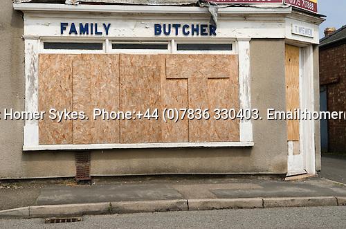 Family Butchers corner shop boareded up closed down Sutton Bridge Lincolnshire. UK 2008.