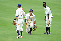 2 May 2010:  FIU's Garrett Wittels (10) tosses the ball to Junior Arrojo (13) after nearly colliding with Pablo Bermudez (12, right) pursuing a fly ball as the University of Louisiana-Monroe Warhawks defeated the FIU Golden Panthers, 8-7 in 11 innings, at University Park Stadium in Miami, Florida.