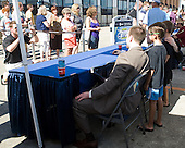 Young fans pose with the Hobey Hat Trick members. - The members of the Hobey Hat Trick joined the Boston College Eagles and Ferris State Bulldogs at an autograph signing at Channelside Bay Plaza on Friday, April 6, 2012, in Tampa, Florida.