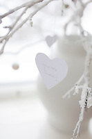 "A paper heart cut-out, with the line ""you are sweet"", hangs on a white-painted branch"
