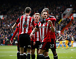 Billy Sharp of Sheffield Utd celebrates Leon Clarke's second goal during the English League One match at Bramall Lane Stadium, Sheffield. Picture date: April 17th 2017. Pic credit should read: Simon Bellis/Sportimage