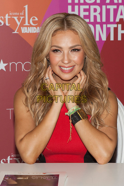 Thalia (Ariadna Thalia Sodi Miranda)<br /> Macy's and Vanidades honor 2013 Icon of Style, Thalia, during Hispanic Heritage month at Herald Square, New York City, NY, USA.<br /> September 26th, 2013<br /> half length black red dress table hands bracelet <br /> CAP/MPC/COR<br /> &copy;Corredor99/ MediaPunch/Capital Pictures
