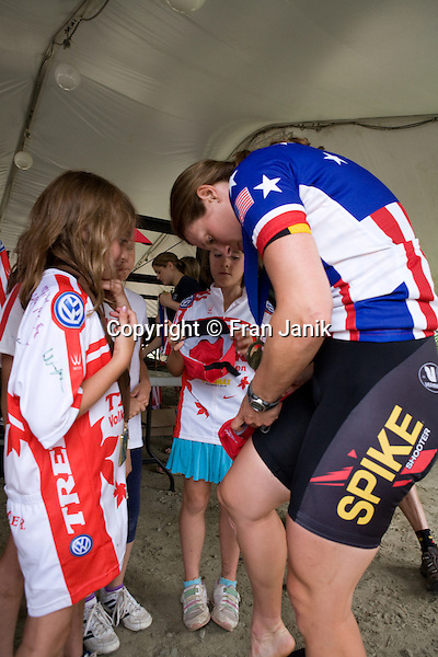 Champion cyclist Mary Mcconneloug 37 of Chilmark MA signs a fan's hat after winning the 2008 Pro womens cross country mountian bike event during the USA cycling mountian bike championships at Mount Snow in Dover Vermont.