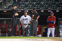 Buffalo Bisons manager Gary Allenson (5) talks with umpires Eric Gillam (left), Robert Moreno (right) and Max Guyll (hidden) at the start of a rain delay with pitching coach Bob Stanley far right during a game against the Lehigh Valley IronPigs on July 9, 2016 at Coca-Cola Field in Buffalo, New York.  Lehigh Valley defeated Buffalo 9-1 in a rain shortened game.  (Mike Janes/Four Seam Images)