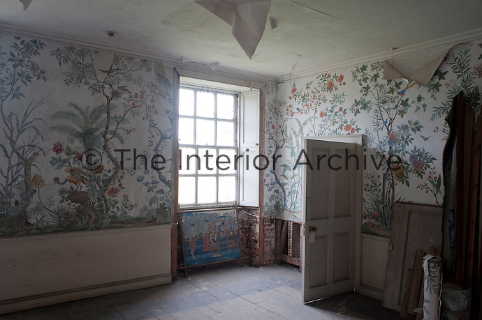 The hand-painted wallpaper is all that remains of a once grand bedroom
