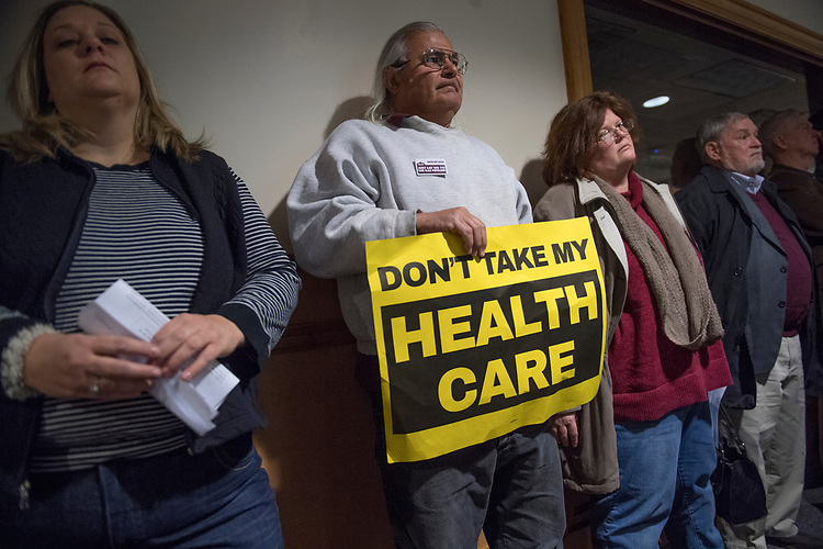 UNITED STATES - MARCH 16: Marc Petitpierre holds a sign a town hall meeting with Sen. Joe Manchin, D-W.Va., at the WVU Robert C. Byrd Health Sciences Center in Martinsburg, W.Va., March 16, 2017. Much of the discussion was regarding the American Health Care Act, the Republican's plan to repeal and replace the ACA. (Photo By Tom Williams/CQ Roll Call)