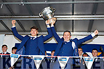 David Clifford and Peter Keane lift the cup at the Kerry minors homecoming to Killarney on Monday evening