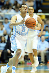 21 December 2013: North Carolina's Marcus Paige. The University of North Carolina Tar Heels played the Davidson College Wildcats at the Dean E. Smith Center in Chapel Hill, North Carolina in a 2013-14 NCAA Division I Men's Basketball game. UNC won the game 97-85 in overtime.