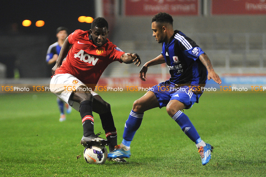 Larnell Cole of Manchester United battles for the ball with Andre Bennett of Middlesbrough - Manchester United Under-21 vs Middlesbrough Under-21 - Barclays Under-21 Premier League Football at Salford City Stadium, Manchester - 20/01/14 - MANDATORY CREDIT: Greig Bertram/TGSPHOTO - Self billing applies where appropriate - 0845 094 6026 - contact@tgsphoto.co.uk - NO UNPAID USE