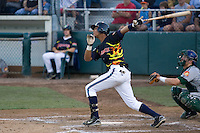 July 19, 2007: Infielder Ogui Diaz of the Everett AquaSox follows through after making contact with a pitch during a Northwest League game at Everett Memorial Stadium in Everett, Washington.