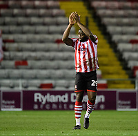 Lincoln City's John Akinde applauds the fans at the final whistle<br /> <br /> Photographer Chris Vaughan/CameraSport<br /> <br /> The Emirates FA Cup Second Round - Lincoln City v Carlisle United - Saturday 1st December 2018 - Sincil Bank - Lincoln<br />  <br /> World Copyright © 2018 CameraSport. All rights reserved. 43 Linden Ave. Countesthorpe. Leicester. England. LE8 5PG - Tel: +44 (0) 116 277 4147 - admin@camerasport.com - www.camerasport.com