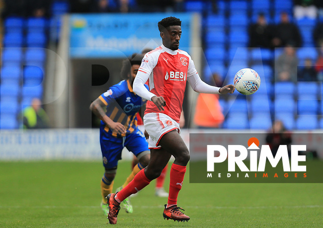 Jordy Hiwula of Fleetwood Town wins the ball during the Sky Bet League 1 match between Shrewsbury Town and Fleetwood Town at Greenhous Meadow, Shrewsbury, England on 21 October 2017. Photo by Leila Coker / PRiME Media Images.