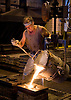 A worker pours molten iron into molds at Kirsh Foundry, Inc., in Beaver Dam, Wisconsin. Photo by Kevin J. Miyazaki/Redux
